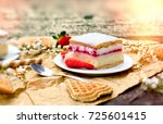 creamy cake with strawberry on... | Shutterstock . vector #725601415