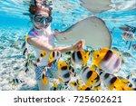 woman snorkeling in clear...   Shutterstock . vector #725602621