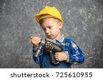 a boy dressed in a blue shirt ... | Shutterstock . vector #725610955