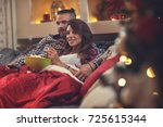 young man and woman in bed... | Shutterstock . vector #725615344
