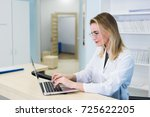 smiling nurse with laptop... | Shutterstock . vector #725622205