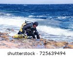 male diver wearing diving tanks ...   Shutterstock . vector #725639494