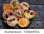 mini pizzas decorated with... | Shutterstock . vector #725644531