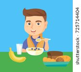 happy caucasian boy sitting at... | Shutterstock .eps vector #725714404