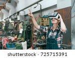 beautiful young industrial... | Shutterstock . vector #725715391