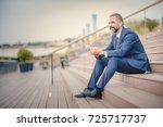 senior businessman relaxing in... | Shutterstock . vector #725717737