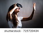 young woman using a virtual... | Shutterstock . vector #725720434