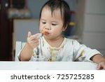 baby asian toddler girl feeding ... | Shutterstock . vector #725725285