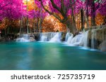 amazing waterfall in colorful... | Shutterstock . vector #725735719