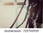 close up nozzle fuel in gas... | Shutterstock . vector #725743939