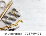 gift box wrapped in black and... | Shutterstock . vector #725749471
