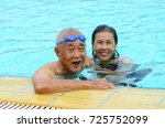 asian father and daughter in a... | Shutterstock . vector #725752099