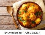 indian fried potatoes dum aloo... | Shutterstock . vector #725768314