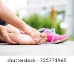 closeup woman massaging her... | Shutterstock . vector #725771965