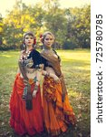 pair of tribal dancers   Shutterstock . vector #725780785