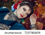 beautiful girl on maple leaf   Shutterstock . vector #725780839