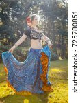 girl in a dress rehearsing dance   Shutterstock . vector #725780851