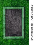 chalkboard on a grass background | Shutterstock . vector #725792569