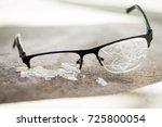 broken glasses on the asphalt.... | Shutterstock . vector #725800054