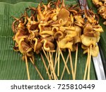 grilled squid on banana leaf... | Shutterstock . vector #725810449