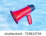 a studio photo of a red mega... | Shutterstock . vector #725813734
