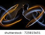 cyclist with dynamic light... | Shutterstock . vector #725815651
