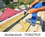 roofing contractor installing... | Shutterstock . vector #725827915