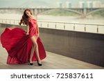 beautiful woman in red... | Shutterstock . vector #725837611