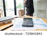 calculater report paper on desk ... | Shutterstock . vector #725841841