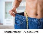 man in oversized pants in... | Shutterstock . vector #725853895