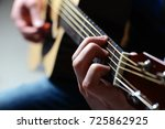 man's hands playing acoustic... | Shutterstock . vector #725862925