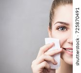 young woman cleaning her face... | Shutterstock . vector #725870491