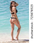 young sexy woman in a black... | Shutterstock . vector #725878525
