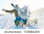 family driving sled on the snow ... | Shutterstock . vector #725886205