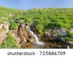 waterfall. morning. mountains | Shutterstock . vector #725886709