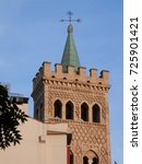 Small photo of Square castle tower with weather wane somewhere in Spain