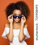 beautiful black woman smiling...   Shutterstock . vector #725908495