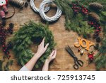 cropped view of florist hands... | Shutterstock . vector #725913745