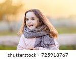 a cute baby girl in an autumn... | Shutterstock . vector #725918767
