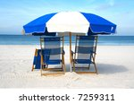 Chairs on the beach (closeup) - stock photo