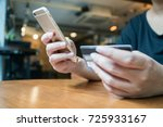 woman hand using smartphone and ... | Shutterstock . vector #725933167