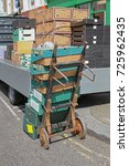 Small photo of Crates and Boxes Delivery With Old Dolly Cart