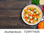 autumnal salad with chickpea ... | Shutterstock . vector #725977435