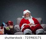 sleepy santa claus taking a nap ... | Shutterstock . vector #725983171