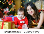 mom with a small son in santa... | Shutterstock . vector #725994499