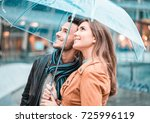 young happy couple under the... | Shutterstock . vector #725996119