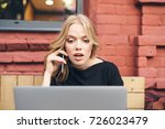 business woman talking on the... | Shutterstock . vector #726023479