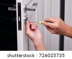 handyman repair the door lock...   Shutterstock . vector #726025735