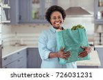 smiling young african woman... | Shutterstock . vector #726031231