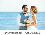 happy wedding couple on sea... | Shutterstock . vector #726033319